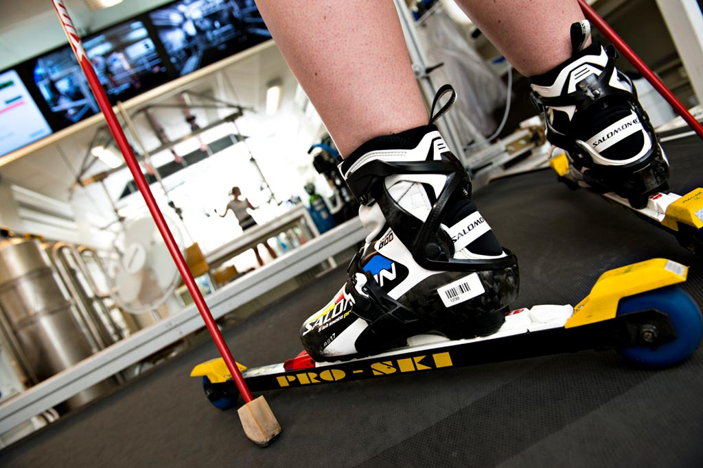 Close up of roller skis on a treadmill in test facility